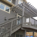 backyard deck with pergola and stairs
