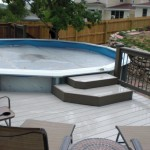 pool deck with steps to pool